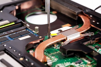 Laptop cooling system repairing process with screw driver